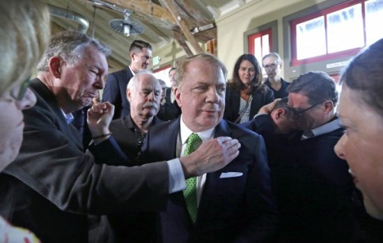 Seattle Mayor Ed Murray is surrounded and embraced by supporters, some in tears, after reading a statement saying that he is dropping his re-election bid for a second term Tuesday, May 9, 2017, in Seattle. (Elaine Thompson/Associated Press)