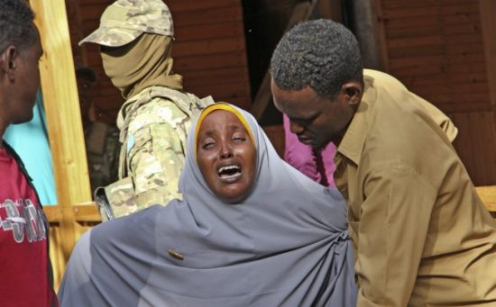 """A mother whose daughter was shot in the head by attackers during a militant attack on a restaurant, grieves in Mogadishu, Somalia Thursday, June 15, 2017. Somalia's security forces early Thursday morning ended a night-long siege by al-Shabab Islamic extremists at the popular """"Pizza House"""" restaurant in the capital. (Farah Abdi Warsameh/Associated Press)"""