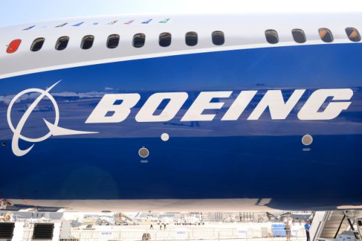 View taken of the Boeing logo on the fuselage of a Boeing 787-10 Dreamliner test plane presented on the Tarmac of Le Bourget on June 18, 2017 on the eve of the opening of the International Paris Air Show. / AFP PHOTO / ERIC PIERMONT        (Photo credit should read ERIC PIERMONT/AFP/Getty Images)