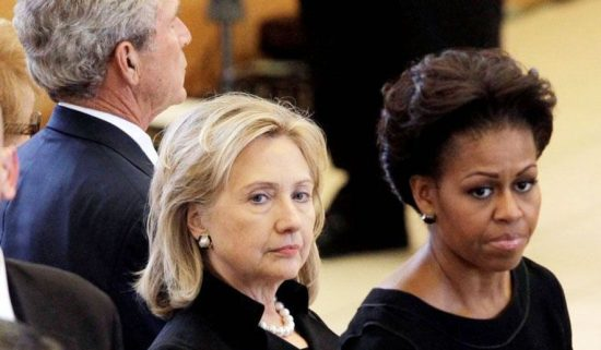 Secretary of State Hillary Rodham Clinton, center, and first lady Michelle Obama stand together during the funeral for former first lady Betty Ford at St. Margaret's Episcopal Church Tuesday, July 12, 2011, in Palm Desert, Calif.