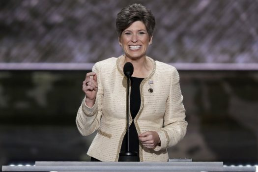 FILE - In this July 18, 2016, file photo, Sen. Joni Ernst, R-Iowa, speaks during the opening day of the Republican National Convention in Cleveland. The Republican base in Iowa is unsettled, with conservatives disappointed by President Donald Trump so far and party leaders saying he's being undermined from within. That's the context for Vice President Mike Pence's headline appearance at Sen. Joni Ernst's annual ``Roast and Ride″ fundraiser. (AP Photo/J. Scott Applewhite, File)