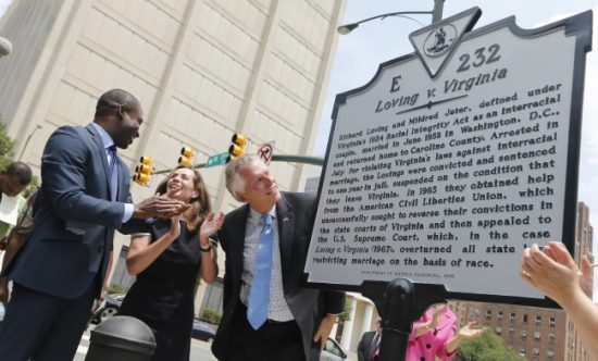 Virginia Gov. Terry McAuliffe , right, looks over a historical marker, along with his wife, Dorothy, center, and Richmond Mayor Levar Stoney, left, that was unveiled commemorating the 50th anniversary of the U.S. Supreme Court decision that struck down bans on interracial marriage Monday, June 12, 2017, in Richmond, Va. The new historical marker to commemorate the lawsuit brought by Richard and Mildred Loving, was dedicated outside the old Virginia Supreme Court, which ruled against the Lovings before they ultimately won in the U.S. Supreme Court. (Steve Helber/Associated Press)