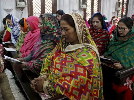 Women sit together at a mass on at All Saints Church in Peshawar, Pakistan, on Dec. 25, 2015. (Photo courtesy of Reuters/Khuram Parvez)