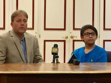 The Rev. Seth Kaper-Dale, pastor of The Reformed Church of Highland Park and Joel, 13, the son of Arino Massey, an ethnic Chinese Christian man, who was deported to Indonesia on Thursday. (Photo: Suzanne Russell/Staff Photo)
