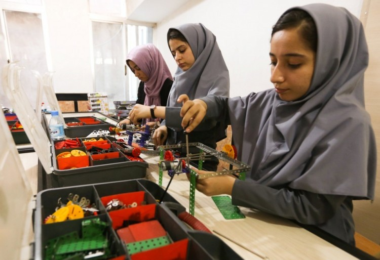 Members of an Afghan robotics team work on their robots in Herat province, Afghanistan, on July 4. (Mohammad Shoib/Reuters)