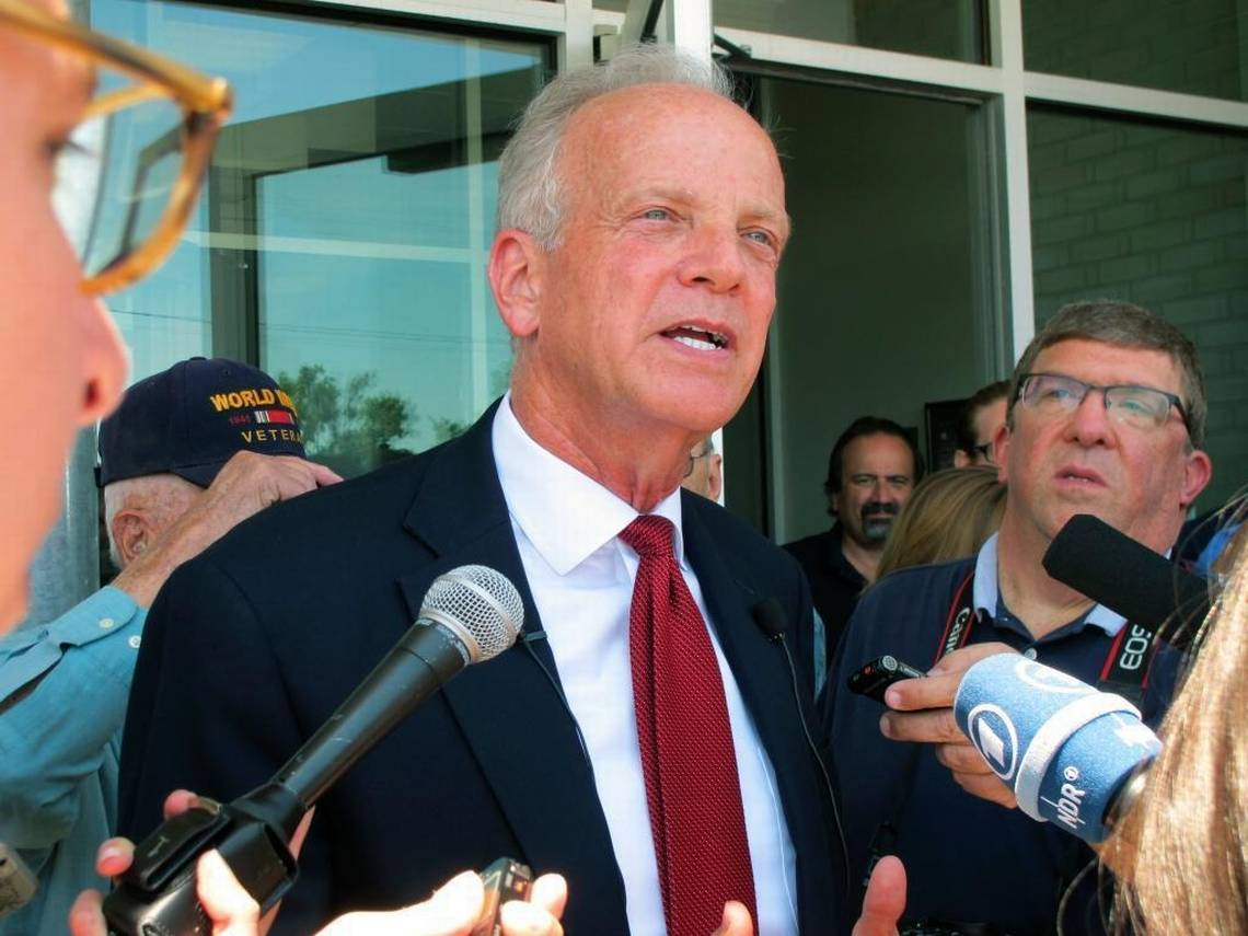 U.S. Sen. Jerry Moran, R-Kan., speaks to reporters following a town hall meeting, Thursday, July 6, 2017, in the tiny town of Palco, Kan. Moran is facing tough questions about GOP efforts to overhaul health care. (John Hanna, AP)