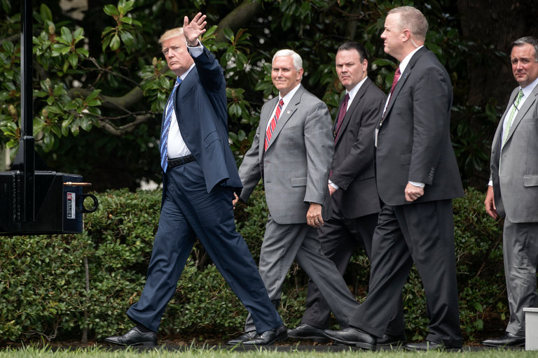 President Trump with Vice President Mike Pence at the White House on Monday. Mr. Trump posted a defense on Twitter of his son's meeting with a Russian lawyer. (Credit: Stephen Crowley/The New York Times)