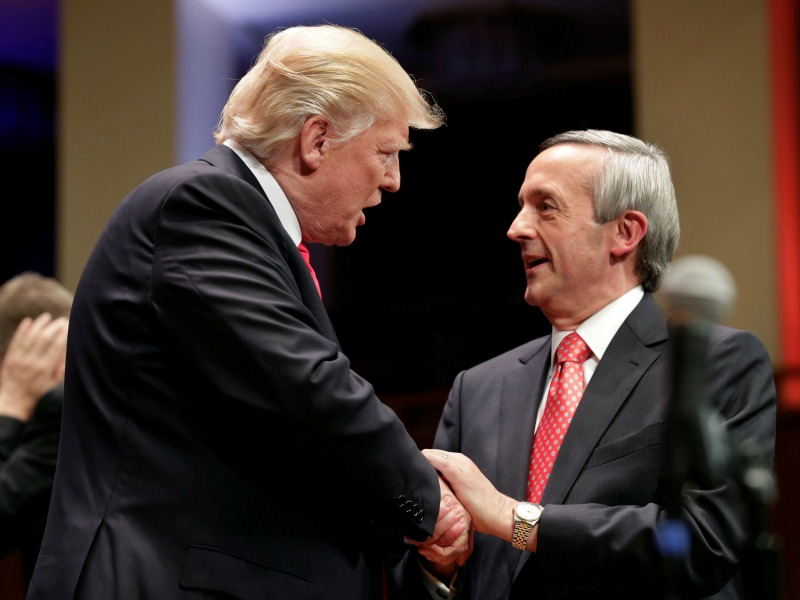 President Trump, left, greets pastor Robert Jeffress on July 1 during the Celebrate Freedom Rally at the John F. Kennedy Center for the Performing Arts in Washington. (Oliver Douliery/Pool/European Pressphoto Agency)