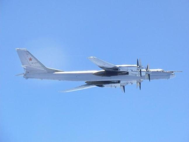 A Russian TU-95 bomber flies over around southern part of Japan in this handout picture taken by Japan Air Self-Defence Force and released by the Joint Staff Office of the Defense Ministry of Japan August 23, 2017. Picture taken August 23, 2017. Joint Staff Office of the Defense Ministry of Japan/HANDOUT via REUTERS