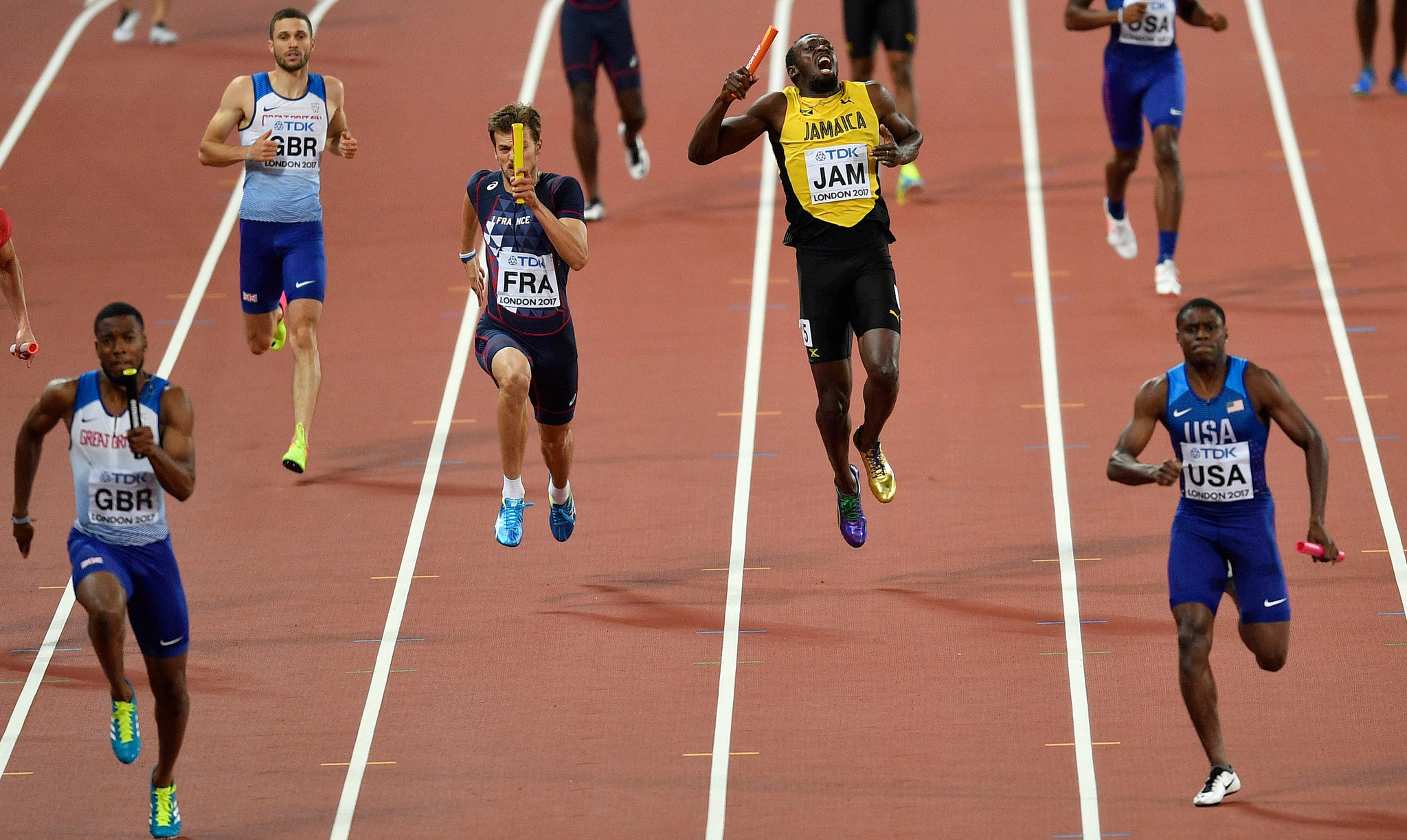 Usain Bolt pulling up with an apparent injury in the men's 4x100-meter relay final at the world track and field championships on Saturday. (Credit: Martin Meissner/Associated Press)
