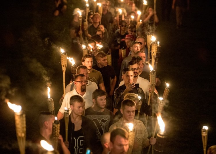 Several hundred white nationalists carrying torches marched in a parade through the University of Virginia campus Friday night. (Evelyn Hockstein for The Washington Post)