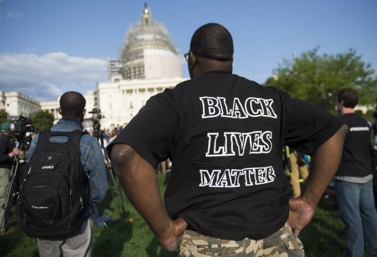 Protesters rally for criminal justice reform outside the U.S. Capitol on April 21, 2015.  (Saul Loeb/AFP via Getty Images)