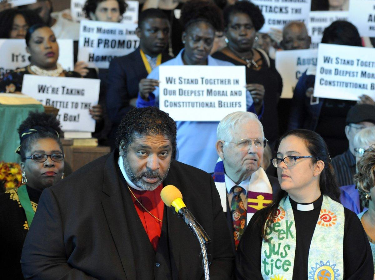 The Rev. William J. Barber speaks at a rally in opposition to Republican U.S. Senate candidate Roy Moore at a church in Birmingham, Ala., on Nov. 18, 2017. (JAY REEVES/AP)