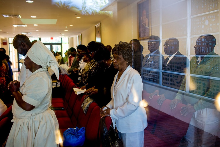 Congregants at Notre Dame d'Haiti Catholic Church in Miami expressed distress on Sunday at President Trump's remarks denigrating Haiti. (Credit: Saul Martinez for The New York Times)