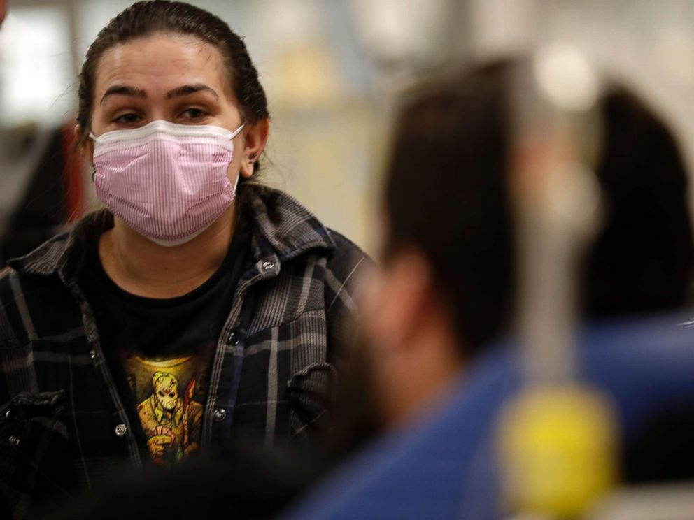 In this Jan. 10, 2018 photo, Torrey Jewett looks on as her roommate Donnie Cardenas recovers from the flu at the Palomar Medical Center in Escondido, Calif. (Gregory Bull/AP)