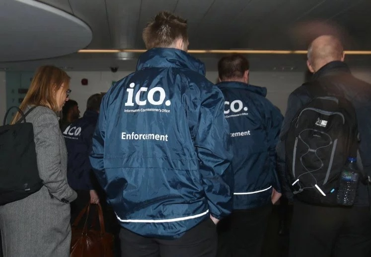 Enforcement officers working for the Information Commissioner's Office entering the premises of Cambridge Analytica in central London (Picture: PA)