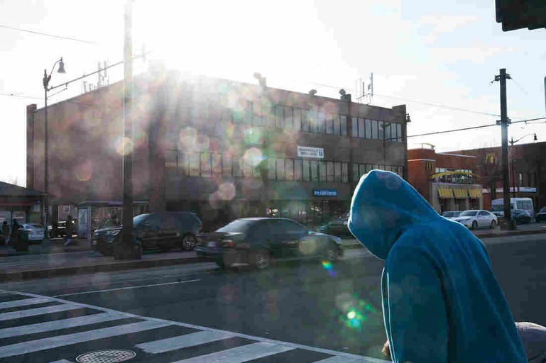 A man walks on Benning Road in Northeast Washington, D.C., in front of the Greater Northeast Medical Center, where Dr. Edwin Chapman works. (Claire Harbage/NPR)