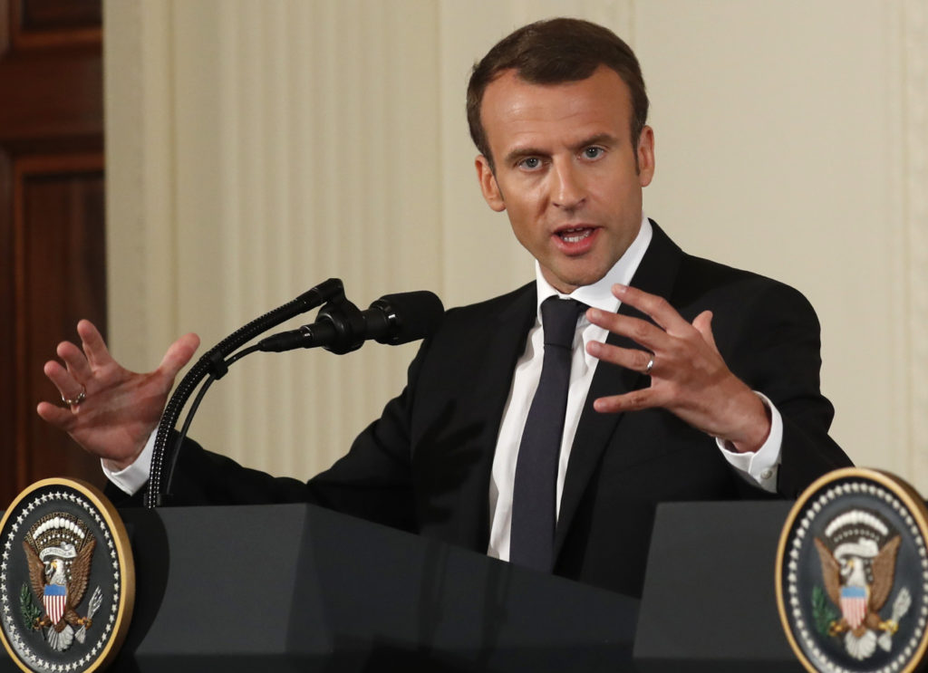 French President Emmanuel Macron speaks during a joint news conference with U.S. President Donald Trump (not pictured) at the White House in Washington, U.S., April 24, 2018. REUTERS/Kevin Lamarque