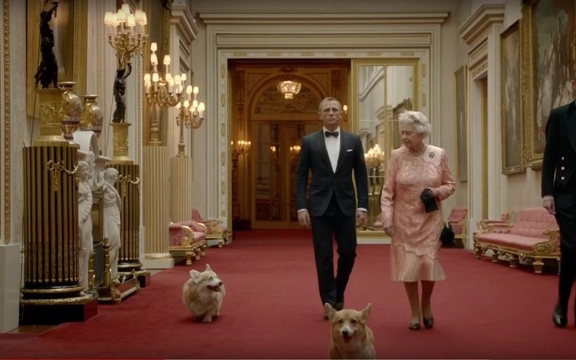 Daniel Craig and Queen Elizabeth II with her corgis (CREDIT: VIDEOGRAB)