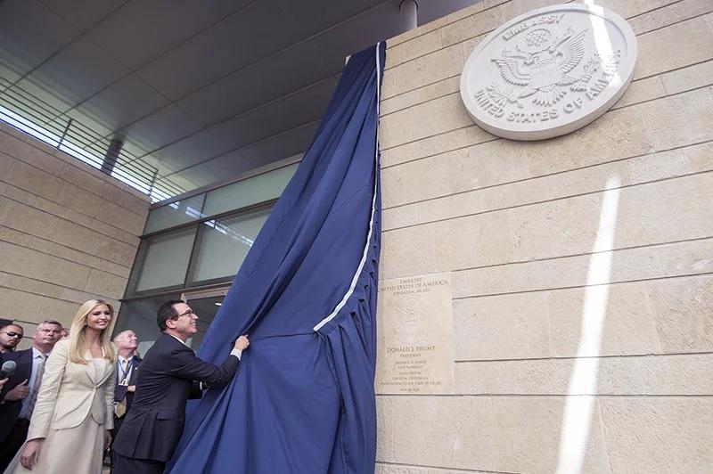 U.S. President Trump's daughter Ivanka, left, and U.S. Treasury Secretary Steve Mnuchin unveil a plaque during the opening ceremony of the new U.S. embassy in Jerusalem, on May 14, 2018. (Flash90 Photo/Yonatan Sindel via AP)