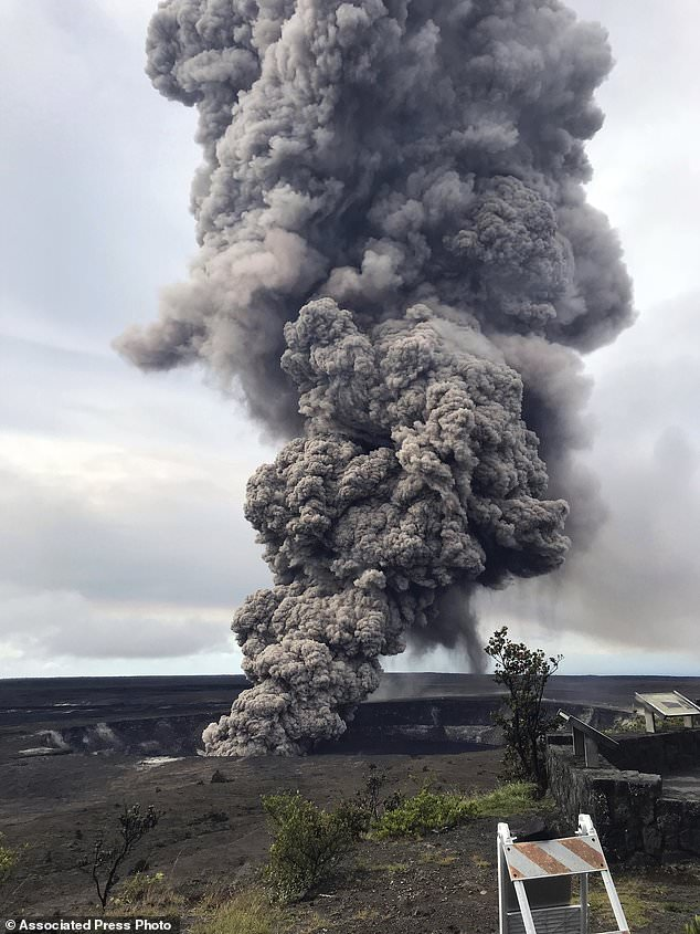 This photo provided by the U.S. Geological Survey shows an ash column rising from the overlook at Halema'uma'u Crater at the summit of Kilauea Volcano in Hawaii Volcanoes National Park on the island of Hawaii at 8:29 a.m. HST Wednesday, May 9, 2018. Hawaii Volcanoes Observatory interprets the short-lived explosion was triggered by a rockfall from the steep walls of the crater. (U.S. Geological Survey via AP)