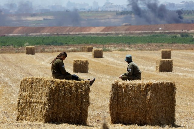 In Israel, a tense, almost pastoral calm prevailed near the Gaza border early Tuesday. (Credit Amir Cohen/Reuters)