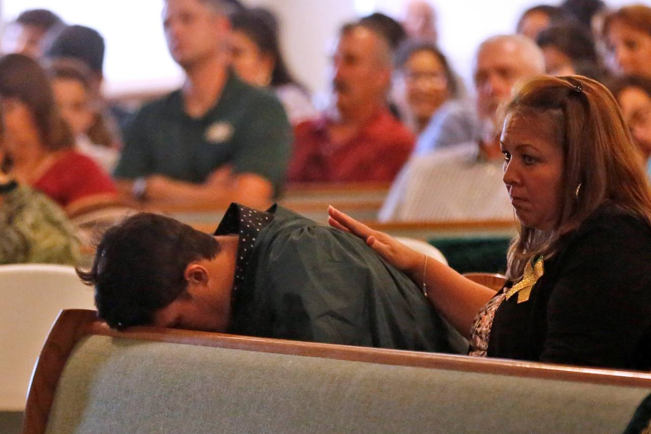A graduating senior from Santa Fe High School mourned the shooting victims during a service at the Arcadia First Baptist Church in Santa Fe, Texas, on Sunday. PHOTO: JONATHAN BACHMAN/REUTERS