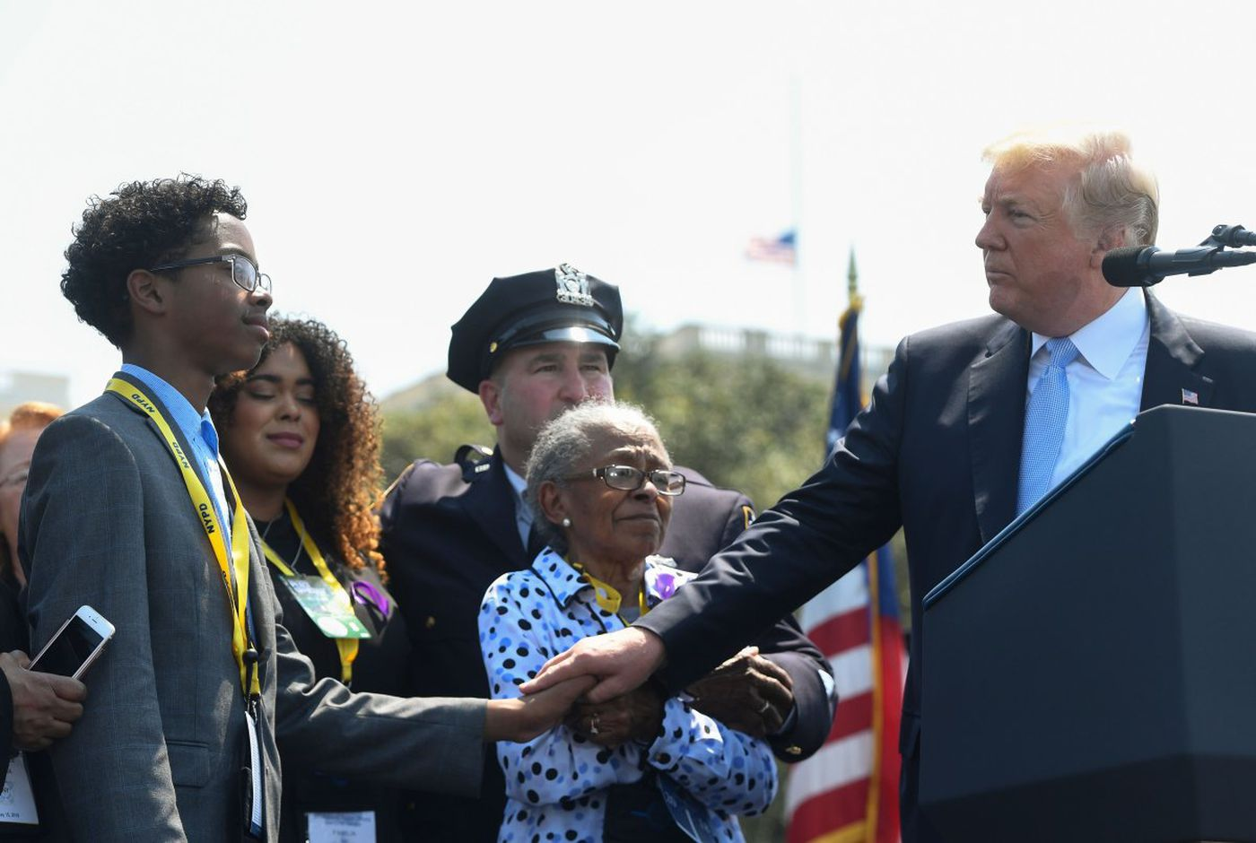 President Trump stands with the family of a fallen police officer Miosotis Familia as he addresses the 37th Annual National Peace Officers Memorial Service. (SAUL LOEB/AFP/Getty Images)