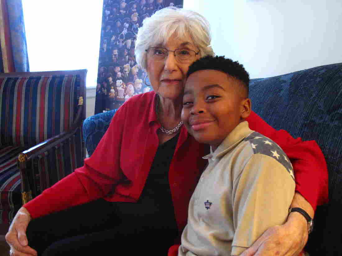 Harriet Glickman, who in 1968 convinced cartoonist Charles Schulz to create a black Peanuts character, sits with Marleik Walker, the boy voicing Franklin in The Peanuts Movie. (Walter Ray Watson/NPR)