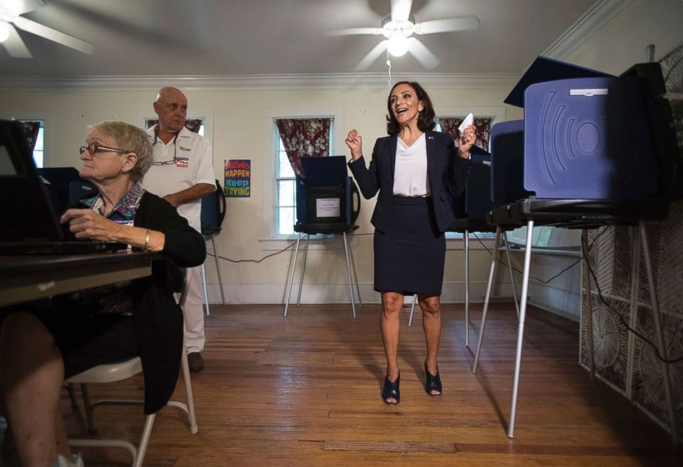 Rep. Katie Arrington, who is running for the first district of South Carolina, celebrates after casting her vote at Bethany United Methodist Church in Summerville, S.C., June 12, 2018.