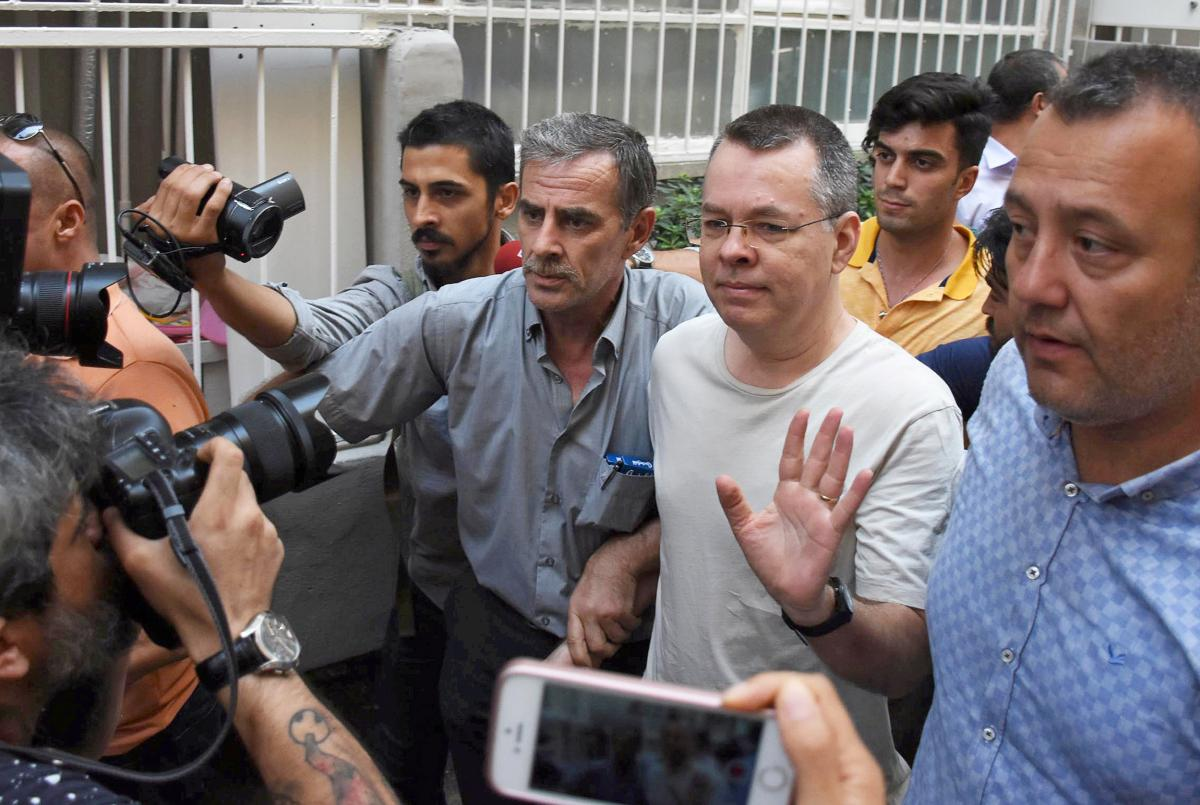 FILE PHOTO: U.S. pastor Andrew Brunson reacts as he arrives at his home after being released from the prison in Izmir, Turkey July 25, 2018. Demiroren News Agency/DHA via REUTERS/File Photo