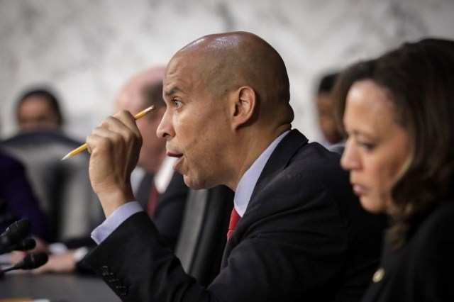 Sen. Cory Booker of New Jersey questions Supreme Court nominee Brett Kavanaugh before the Senate Judiciary Committee on Sept. 6. Kavanaugh stands accused of sexual misconduct, a topic that Booker addressed in a column for his college newspaper. (Drew Angerer/Getty Images)