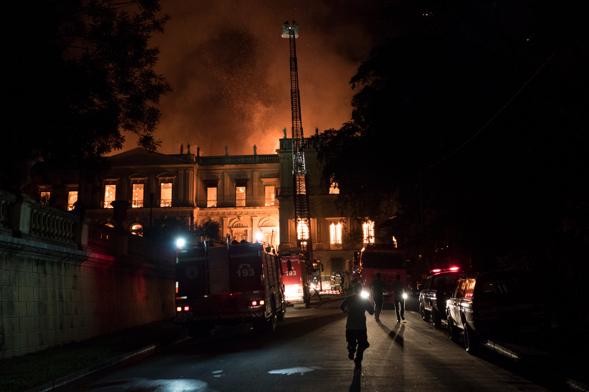 Firefighters battling a blaze on Sunday at the 200-year-old National Museum of Brazil in Rio de Janeiro. (Credit: Leo Correa/Associated Press)