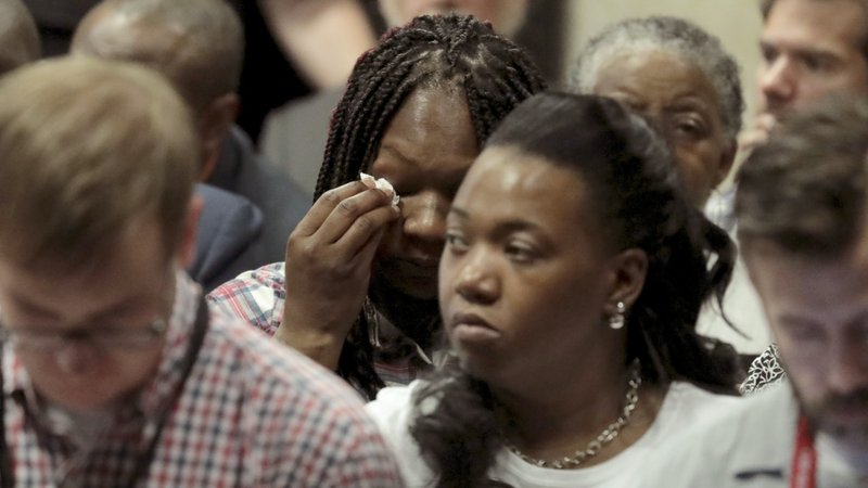 Tina Hunter, center, wipes her eyes as she watches from the gallery during Chicago Police Officer Jason Van Dyke's trial for the shooting death of her son Laquan McDonald, at the Leighton Criminal Court Building on Thursday, Sept. 20, 2018.(Antonio Perez/ Chicago Tribune via AP, Pool)