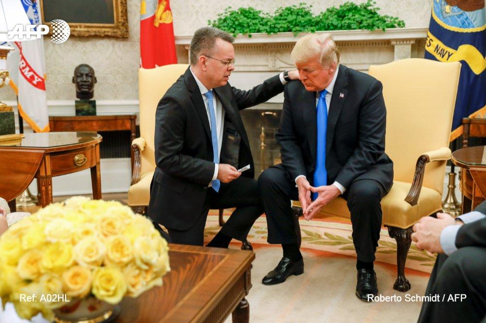 Pastor Andrew Brunson prays for President Trump in the Oval Office.