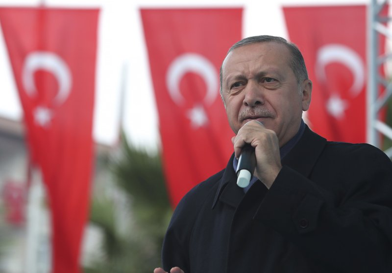 Turkish President Recep Tayyip Erdogan, delivers a speech at supporters in Istanbul, Sunday, Oct. 21, 2018. Erdogan says he will announce details of the Turkish investigation into the death of Saudi writer Jamal Khashoggi's on Tuesday. (Presidential Press Service via AP, Pool)