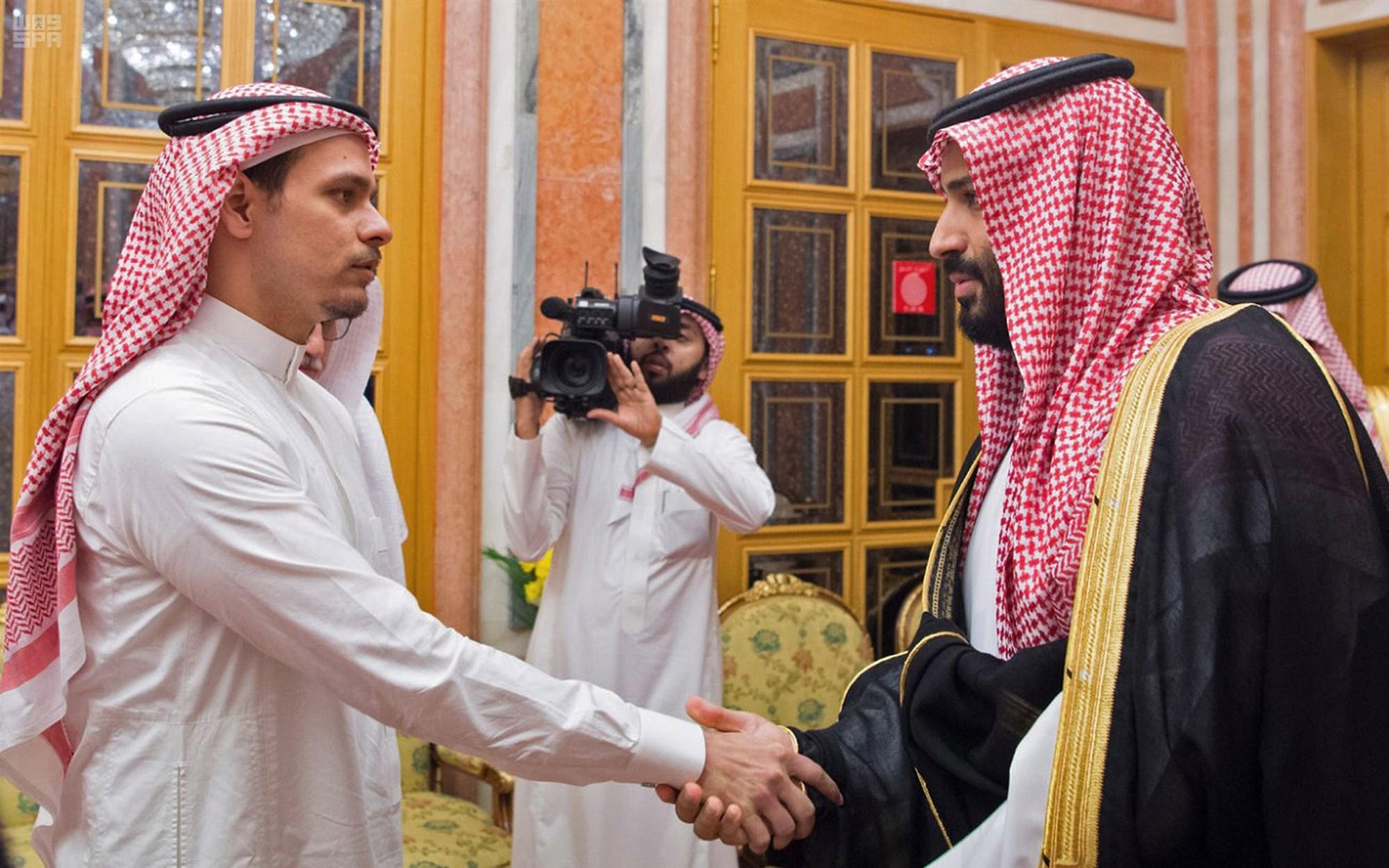 Saudi Crown Prince Mohammed bin Salman, right, shakes hand with Jamal Khashoggi's son Salah in Riyadh. (Credit: Saudi Press Agency / AFP - Getty Images)