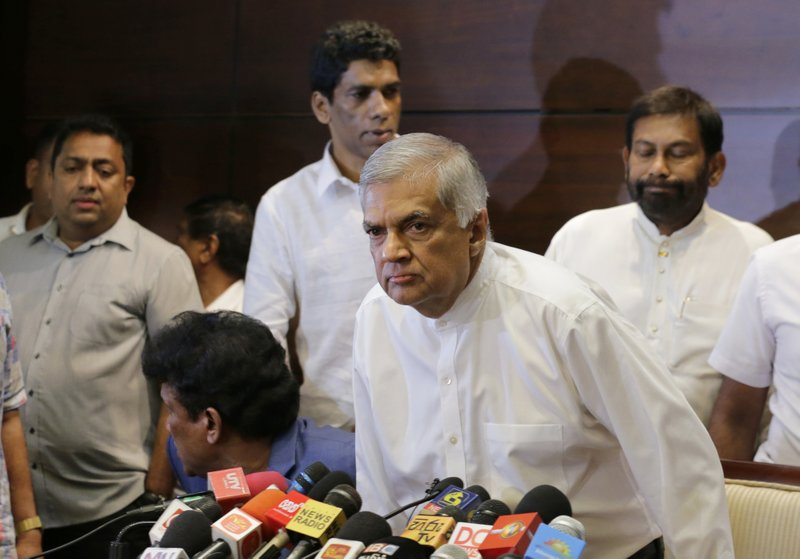 Sri Lanka's sacked Prime Mminister Ranil Wickeremesinghe attends a media briefing in Colombo, Sri Lanka, Saturday, Oct. 27, 2018. Sri Lankan President Maithripala Sirisena sacked Wickremesinghe and his Cabinet and replaced him with a former strongman, creating what some observers said could be a constitutional crisis. (AP Photo/Eranga Jayawardena)