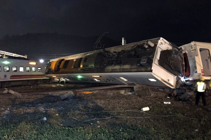 In this photo released by Taiwan Railways Administration, train carriages are scattered at the site of a train derailment in Lian in northern Taiwan on Sunday, Oct. 21, 2018. The Puyuma express train was carrying more than 300 passengers toward Taitung, a city on Taiwan's southeast coast, when it went off the tracks on Sunday afternoon. (Taiwan Railways Administration via AP)