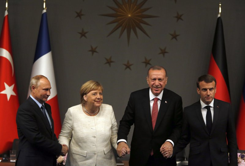 Click to copyhttps://apnews.com/f65417351e5142379e0bc9c89c92b692 RELATED TOPICS Turkey Istanbul International News Middle East Summits France Angela Merkel Germany Bashar Assad Syria Emmanuel Macron Europe Russia Syrians must lead peace efforts, leaders say at Turkey talks By CHRISTOPHER TORCHIA 22 minutes ago Recep Tayyip Erdogan, Angela Merkel, Emmanuel Macron, Vladimir Putin 1 of 21 From left, Russian President Vladimir Putin, German Chancellor Angela Merkel, Turkey's President Recep Tayyip Erdogan and French President Emmanuel Macron pose at the end of a news conference following their summit on Syria, in Istanbul, Saturday, Oct. 27, 2018. The leaders of Turkey, Russia, France and Germany were gathering for a summit Saturday in Istanbul about Syria, hoping to lay the groundwork for eventual peace in a country devastated by years of war. (AP Photo/Lefteris Pitarakis)