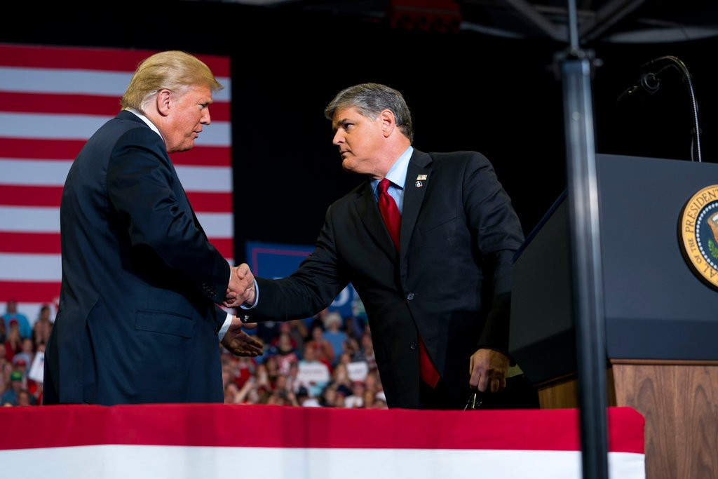 President Trump invited Sean Hannity onstage during a rally in Cape Girardeau, Mo., on Monday, the final day of campaigning before the midterm elections. (Credit: Doug Mills/The New York Times)