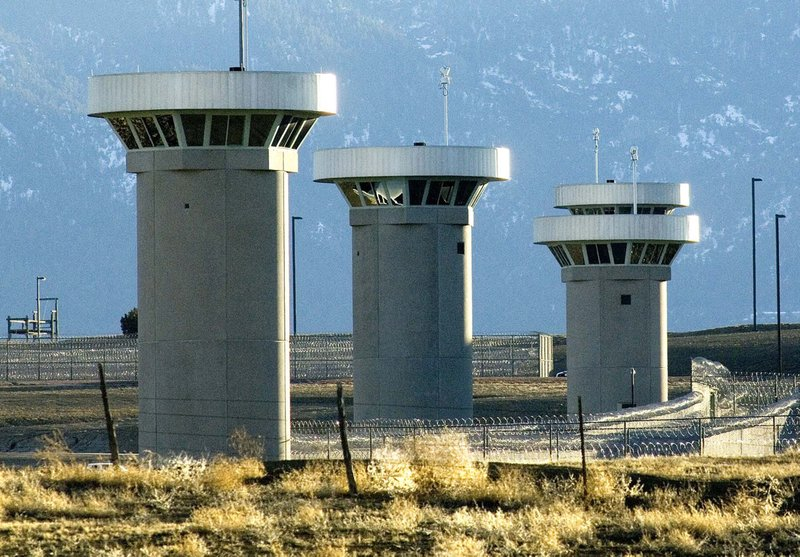 """FILE - In this Feb. 21, 2007, file photo, guard towers loom over the administrative maximum security federal prison called Supermax near Florence, Colo. Experts say the drug lord Joaquin """"El Chapo"""" Guzman, who will be sentenced on June 25, 2019, for smuggling enormous amounts of narcotics into the U.S and having a hand in dozens of murders, seems the ideal candidate for """"Supermax"""" prison also known as ADX for """"administrative maximum,"""" a facility so secure, so remote and so austere that it has been called the """"Alcatraz of the Rockies."""" (Chris McLean/The Pueblo Chieftain via AP)"""