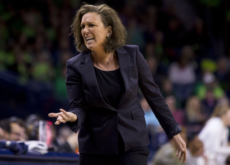 """FILE - In this Feb. 3, 2019, file photo, Georgia Tech head coach MaChelle Joseph yells to her bench during an NCAA college basketball game against Notre Dame in South Bend, Ind. A lawyer for Georgia Tech coach MaChelle Joseph says the coach hasn't been told why she has been suspended and is left to assume the action is retaliation for her concerns about gender equity matters. Joseph's lawyer, Lisa Banks, said in a statement to The Associated Press on Thursday, Feb. 28, 2019, that Georgia Tech """"failed to provide any explanation"""" for the suspension. (AP Photo/Robert Franklin, File)"""