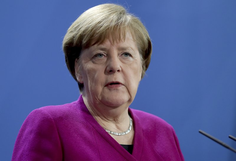 German Chancellor Angela Merkel addresses the media during a joint press conference as part of a meeting with the Prime Minister of Latvia, Krisjanis Karins in Berlin, Germany, Monday, March 11, 2019. (AP Photo/Michael Sohn)