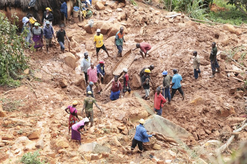 A family dig for their son who got buried in the mud when Cyclone Idai struck in Chimanimani about 600 kilometres south east of Harare, Zimbabwe, Tuesday, March, 19, 2019. According to the government, Cyclone Idai has killed more than 100 people in Chipinge and Chimanimani and according to residents the figures could be higher because the hardest hit areas are still inaccessible. Some hundreds are dead, many more are missing, and some thousands at risk from the massive flooding in Mozambique, Malawi and Zimbabwe caused by Cyclone Idai.(AP Photo/Tsvangirayi Mukwazhi)
