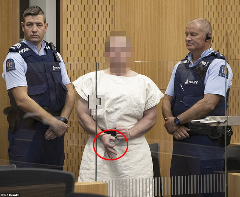 Accused Christchurch massacre gunman Brenton Harrison Tarrant (pictured) has made a white power gesture from behind a glass window, during a brief appearance in court.