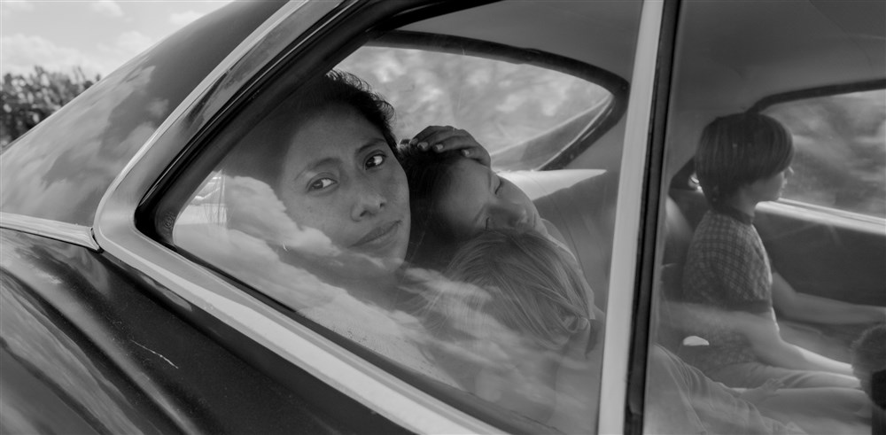 Yalitza Aparicio as Cleo, Marco Graf as Pepe, Carlos Peralta Jacobson as Paco, and Daniela Demesa as Sofi in Roma. (Alfonso Cuaron / Netflix)