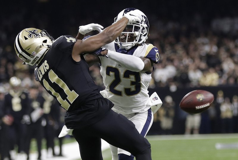 FILE - In this Jan. 20, 2019, file photo, Los Angeles Rams' Nickell Robey-Coleman breaks up a pass intended for New Orleans Saints' Tommylee Lewis during the second half of the NFL football NFC championship game in New Orleans. NFL teams have proposed major changes to replay and overtime after a season of consistent criticism of officiating and which plays can be challenged or automatically reviewed. The competition committee will present teams' proposals and some of its own to the 32 owners at the league meetings March 24-27. (AP Photo/Gerald Herbert, File)