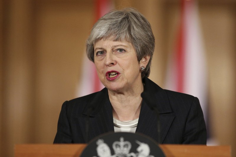 """Britain's Prime Minister Theresa May delivers a statement, at 10 Downing Street, in London, Wednesday, March 20, 2019. May says it's a matter of """"great personal regret"""" that U.K. won't leave the EU with a deal on March 29. (Jonathan Brady/Pool Photo via AP)"""