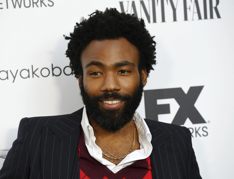 """FILE - In this Sept. 16, 2018 file photo, Donald Glover, creator and star of the FX series """"Atlanta,"""" and a musician who performs under the name Childish Gambino, poses at a private cocktail party to celebrate the FX network's Emmy nominations in Los Angeles. Glover and Rihanna's secretive new film """"Guava Island"""" is coming to Amazon Prime Video this weekend. Glover tweeted Wednesday, April 10, 2019, that it'd be available to stream for free starting Saturday at 12:01 am. (Photo by Chris Pizzello/Invision/AP, File)"""